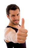 Young male with thumbs up. On an isolated white background Royalty Free Stock Image