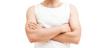 Young male torso with crossing hands, isolated Royalty Free Stock Image