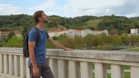 Young male tourist enjoying picturesque view and warm weather in Bilbao, Spain