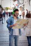 Young male tourist lost and looking around. Man travels with map. Young male tourist lost and looking around Stock Images