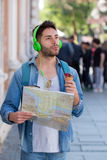 Young male tourist lost and looking around. Man travels with map. Young male tourist lost and looking around Stock Photography