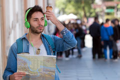 Young male tourist lost and looking around. Man travels with map. Young male tourist lost and looking around Royalty Free Stock Photos