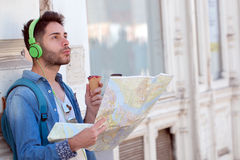 Young male tourist lost and looking around. Man travels with map. Young male tourist lost and looking around Royalty Free Stock Photography