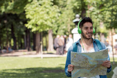 Young male tourist lost and looking around. Man travels with map. Young male tourist lost and looking around Royalty Free Stock Images