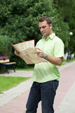 Young male tourist lost and looking around. Young male tourist with map in hand looking around. Tourist map of the city of Moscow, Russia (no trademark Stock Photo
