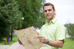 Young male tourist with map in hand good looking. Tourist map of the city of Moscow, Russia (no trademark Stock Photo