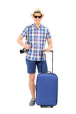 Young male tourist posing with his baggage Royalty Free Stock Images