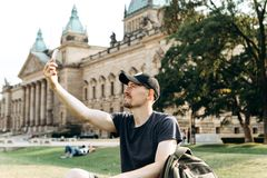 A tourist man uses a mobile phone stock photo