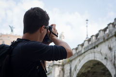 Young male tourist taking photos Royalty Free Stock Photography