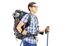 Young male tourist walking with hiking poles. Isolated on white background Royalty Free Stock Images