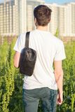 Young male traveler with bag royalty free stock photo