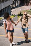 young male traveler with camera and stylish african american girlfriend stock photography