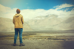 Free Young Male Traveler Standing On The Sand Cliff, Thinking About Or Looking Forward To Something In Leh, Ladakh,India Royalty Free Stock Photography - 80007627