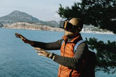 Young Male Traveler in virtual glasses on the background of the. Sea Stock Photography