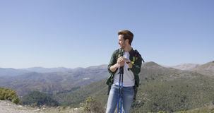 Young male with trekking poles looking away Royalty Free Stock Photos