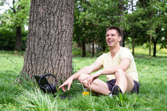 Young male using laptop in park Stock Images