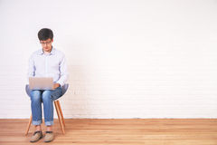 Young male using notebook Stock Photo