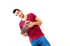 Young male using tablet. Portrait of a young man in red shirt using tablet Stock Photo