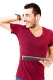 Young male using tablet. Portrait of a young man in red shirt using tablet Royalty Free Stock Image