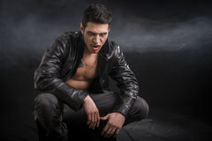 Young Male Vampire in Black Leather Jacket Royalty Free Stock Photography