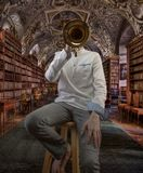 Young Male Violinist in Fancy Library. Musician in old architectural structure playing violin with horn blocking face Stock Photos