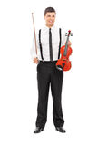 Young male violinist posing. Full length portrait of a young male violinist posing isolated on white background Royalty Free Stock Images