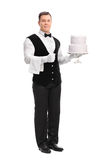 Young male waiter holding a cake Stock Photos