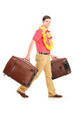 Young male walking with his luggage. Full length portrait of a young male walking with his luggage  on white background Stock Images