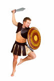 Young male warrior with a shield Royalty Free Stock Image