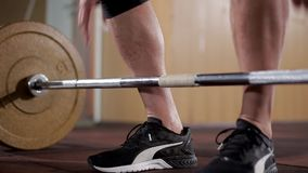 Young Male Weightlifter In Sneakers Takes The Barbell. And Lifts It During A Workout At The Gym. The Concept Of Physical Activity And Training stock video