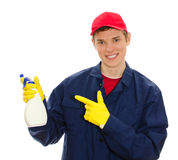Young male window cleaner. Holding cleanser. Isolated on white Royalty Free Stock Images