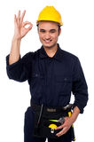 Young male worker giving the ok sign Stock Photo