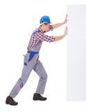 Young Male Worker Pushing Placard Stock Images