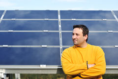Young male worker with solar panels Royalty Free Stock Image