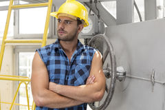 Young male worker standing arms crossed in industry Stock Photography
