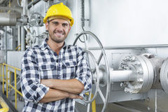 Young male worker standing arms crossed in industry Stock Images
