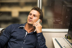Young male worker talking on the phone Stock Photography