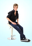 Young malevsitting on chair Stock Image