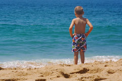 Young man. A young boy wishing he could go out in the ocean Stock Images