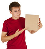 Young man. Man points to the box, on a white background royalty free stock photos