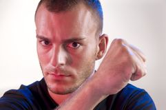 Young man. Studio shoot of young caucasian angry man Stock Photo