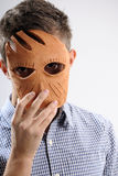 Young man. White, young, handsome man  holding mask on face Stock Photography