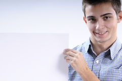 Young man. White, young, handsome man  showing white paper Stock Photos