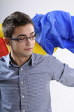 Young man. Happy young man showing romanian national flag for his favoured team victory Royalty Free Stock Photography