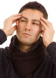Young man. Close-up of a young man that has an intense headache, isolated on white Royalty Free Stock Image