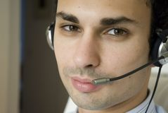 Young man. With the headset Royalty Free Stock Photography
