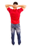Young man. Young casual man full body from behind, isolated on white background Royalty Free Stock Photos