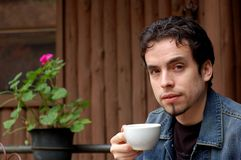 Young Man. A young man having a cup of coffee at restaurant's terrace Royalty Free Stock Image