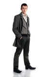 Young man. Young guy wearing overcoat studio shot Royalty Free Stock Photography