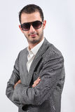 Young Man. Portrait of a young man is wearing big sunglasses and jacket Royalty Free Stock Photos